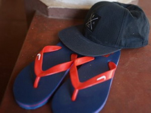 A sample of the sandals and caps given out