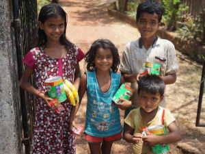 Children receiving their donations from Nestle